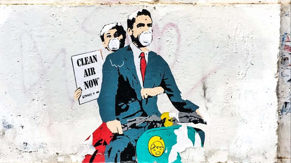 """graffiti of man + woman on moped with sign """"Clean Air Now"""""""